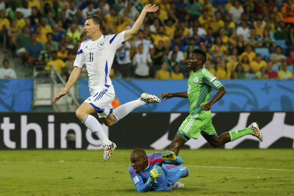 Bosnia's Edin Dzeko, left, scores a disallowed goal past Nigeria's goalkeeper Vincent Enyeama.