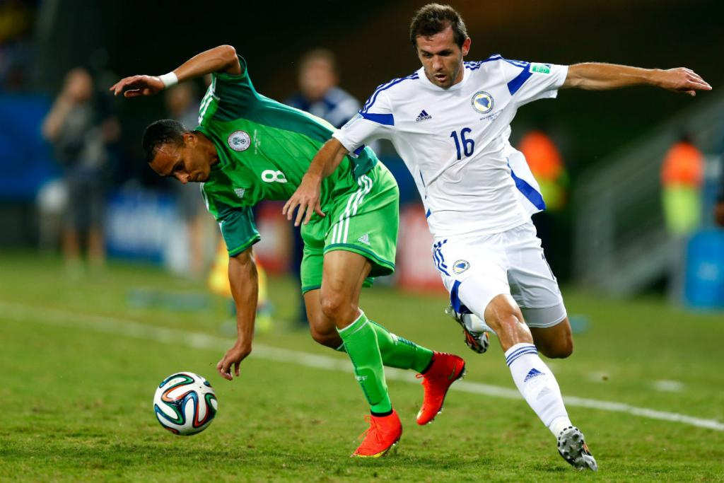 Nigeria's matchwinner Peter Odemwingie is challenged by Bosnia's Senad Lulic.