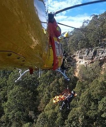 REMARKABLE SURVIVAL: Paramedics use a helicopter to rescue a 17-year-old who fell 80 metres at Australia's Watagan Mountains.
