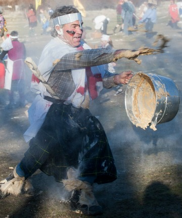 FLOUR POWER: Frank O'Neil gets into the spirit of things at the Battle of Bannockburn yesterday.