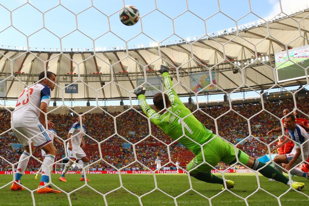 Belgian teenager Divock Origi scores his team's only goal past Igor Akinfeev of Russia during the Group H match between Belgium and Russia at Maracana in Rio de Janeiro.