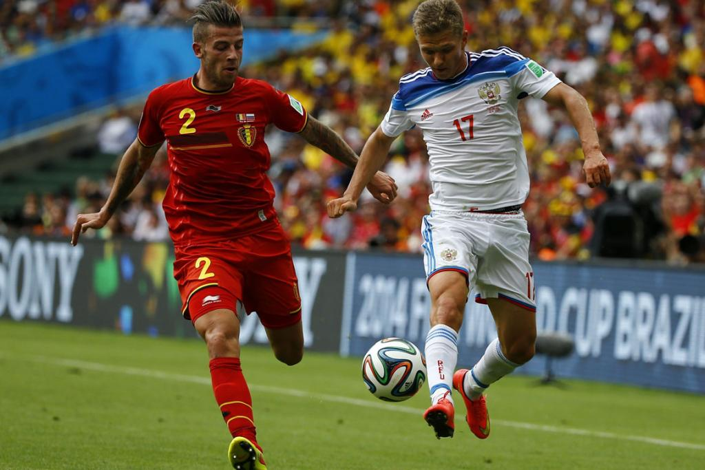Russia's Alexey Kozlov (right) fights for the ball during his side's 1-0 loss to Belgiumi.
