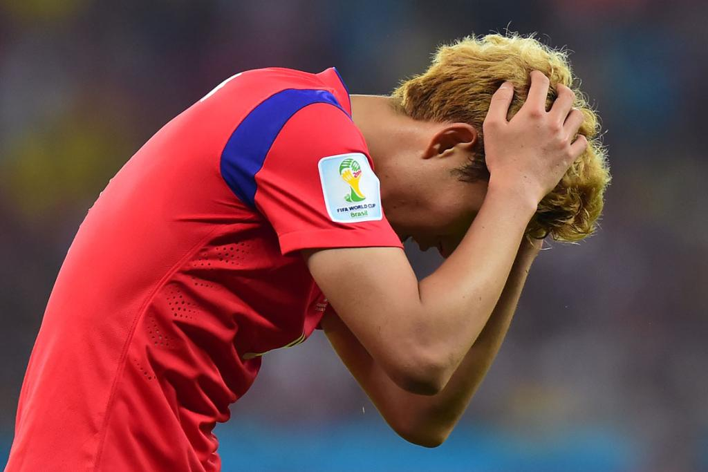 A dejected Son Heung-Min of South Korea walks off the pitch after a 4-2 loss to Algeria at Estadio Beira-Rio in Porto Alegre, Brazil.