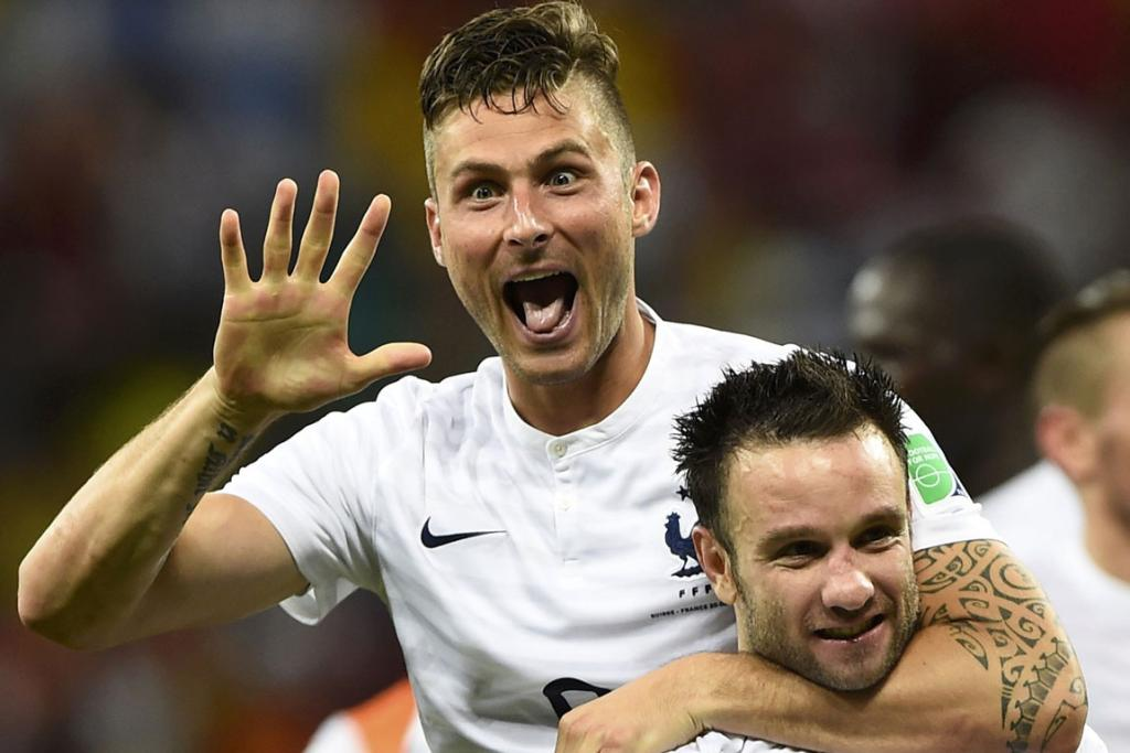 France's Olivier Giroud (top) celebrates with teammate Mathieu Valbuena their team's victory over Switzerland.