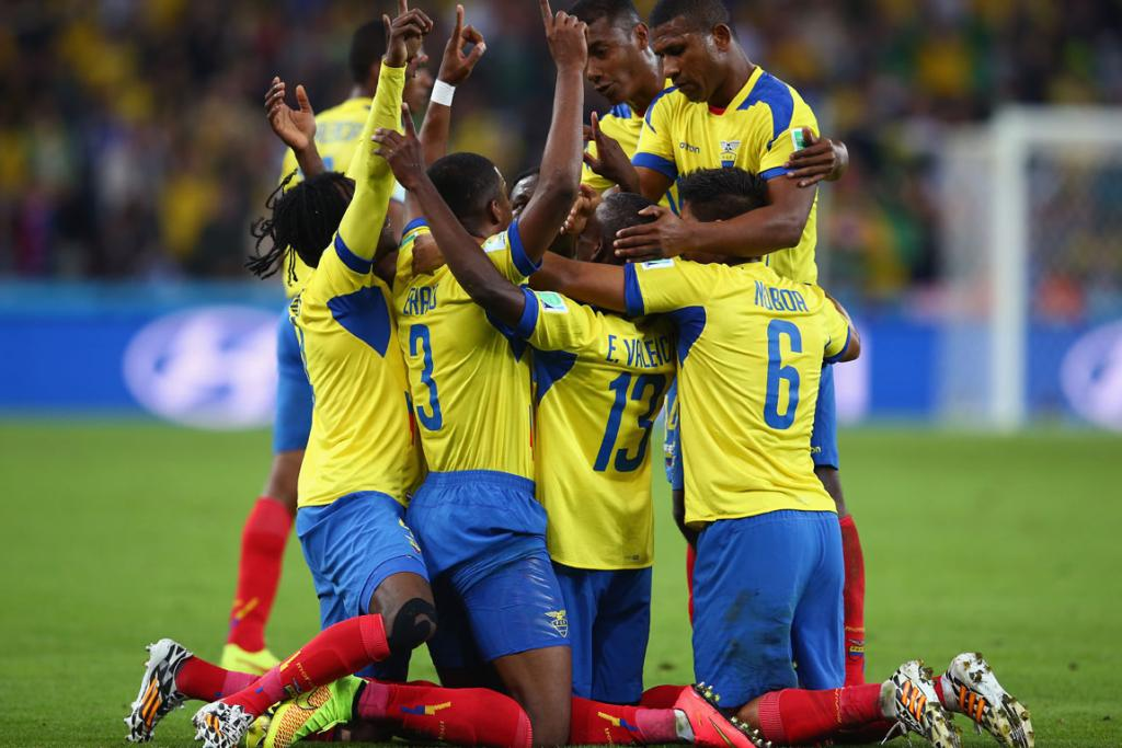 Enner Valencia (No 13) of Ecuador celebrates with teammates after scoring his side's second goal against Honduras at Arena da Baixada in Curitiba, Brazil.