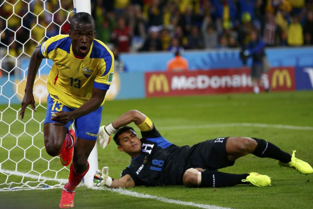 Ecuador's Enner Valencia celebrates after scoring a goal past goalkeeper Noel Valladares of Honduras during their 2014 World Cup Group E football match at the Baixada arena in Curitiba.