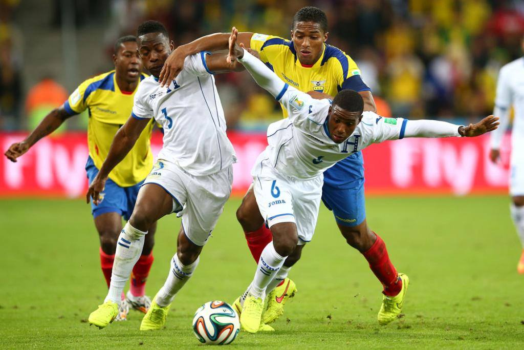 Juan Carlos Garcia of Honduras controls the ball past Antonio Valencia of Ecuador during their clash at the World Cup.
