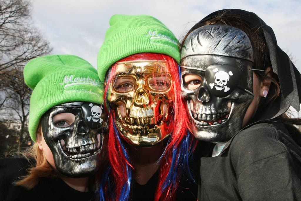 Three kids in masks