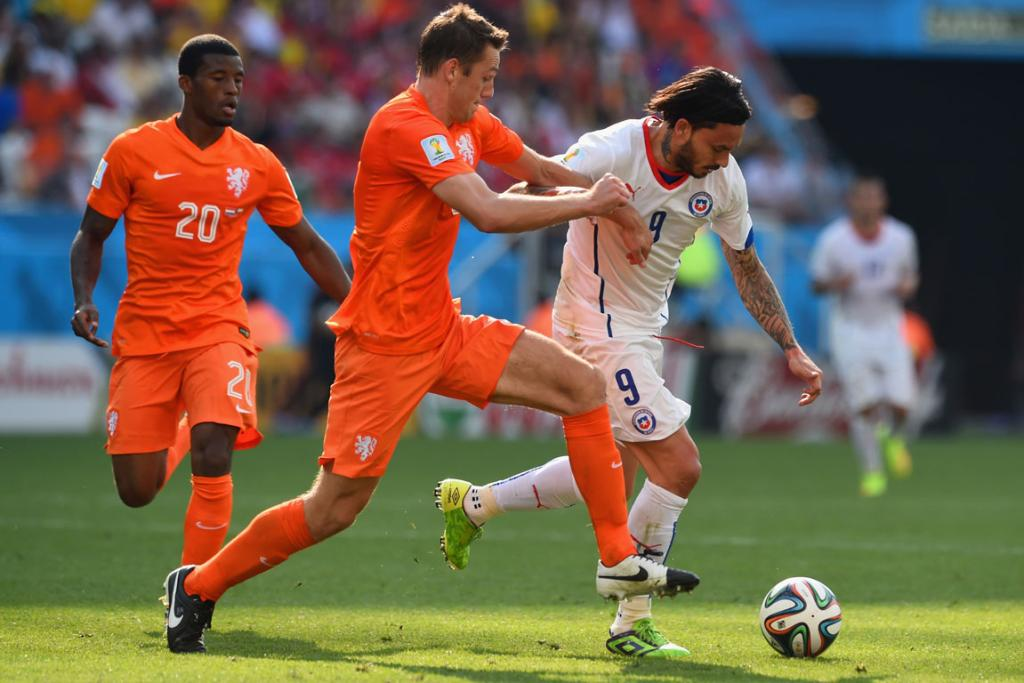Stefan de Vrij of the Netherlands and Mauricio Pinilla of Chile compete for the ball during the Group B match between the Netherlands and Chile at Arena de Sao Paulo in Sao Paulo, Brazil.