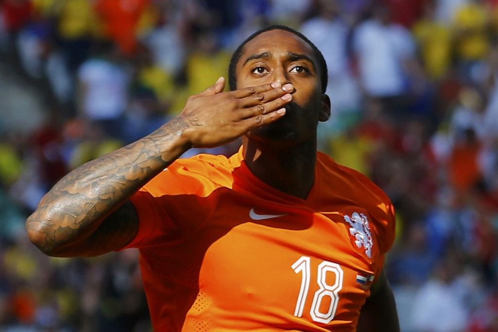 Leroy Fer of the Netherlands celebrates after scoring a goal against Chile at the Corinthians arena in Sao Paulo, Brazil.