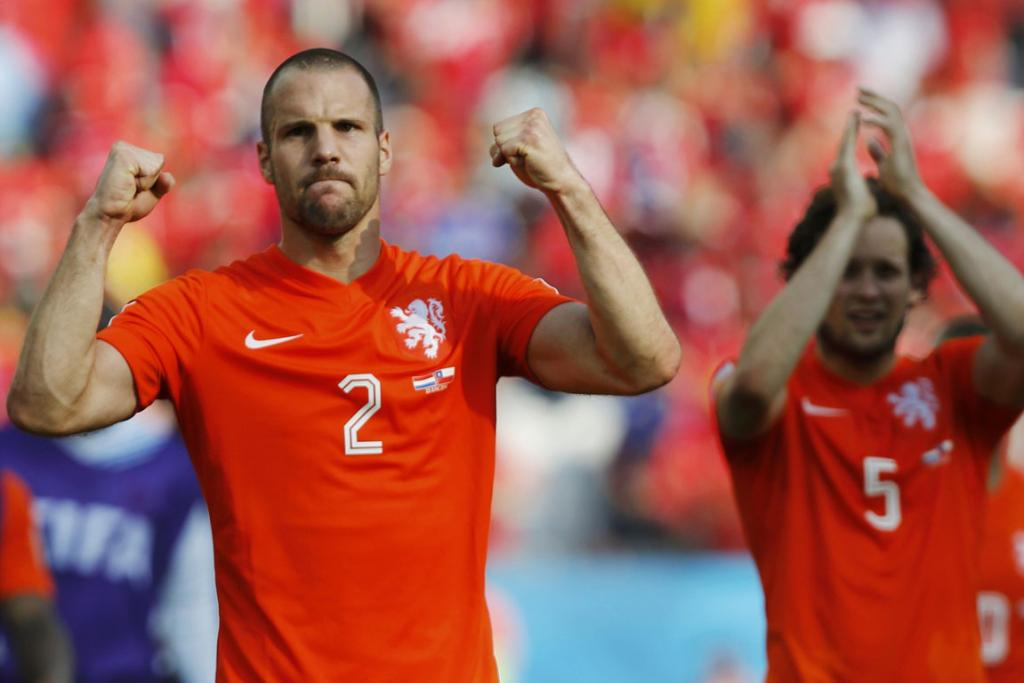 Ron Vlaar (left) and Daley Blind of the Netherlands celebrate after defeating Chile after their 2014 World Cup Group B football match at the Corinthians arena in Sao Paulo.