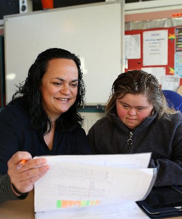 Ruru School deputy principal Hera Fisher, back in the classroom after attending an autism and behaviour course in London, works with pupil Courtney Cleghorn, 19.