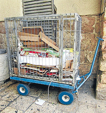 POSITIVE: Cardboard recycling in the narrow lanes of the old city of Jerusalem.