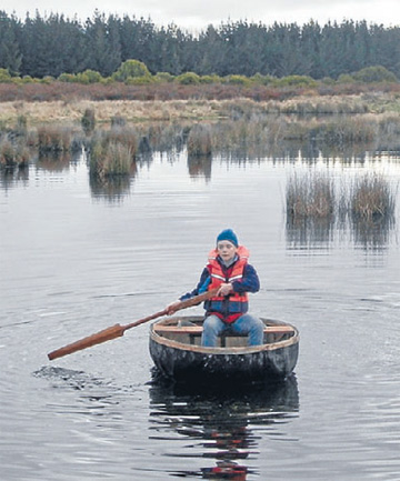 Iona Brimecombe in a coracle made by her father Paul, of Te Anau.