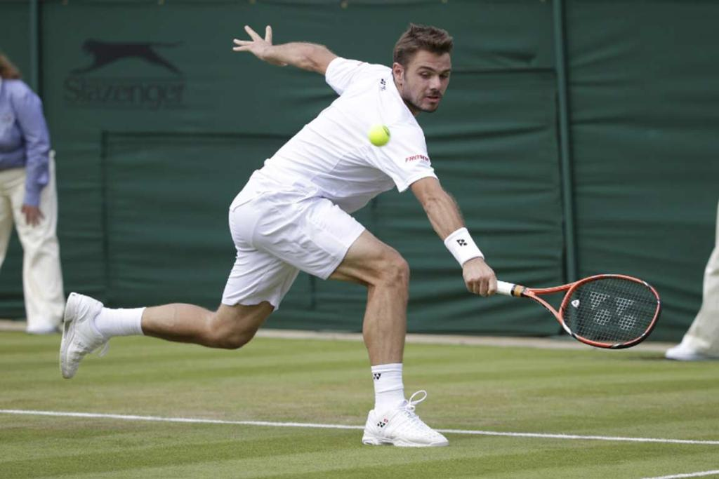 Stanislas Wawrinka stretches for a backhand shot during his first-round straight sets victory over Portugal's Joao Sousa.
