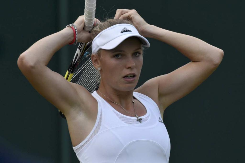 Caroline Wozniacki adjusts her ponytail during her victory over Israel's Shahar Peer.