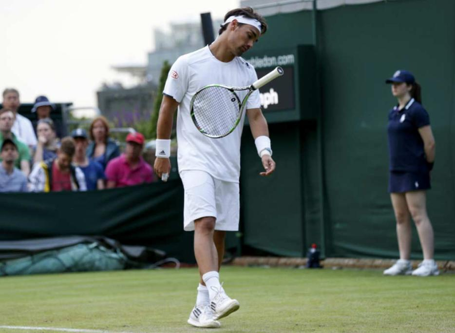 Fabio Fognini throws his racquet to the turf after losing a point to Alex Kuznetsov.