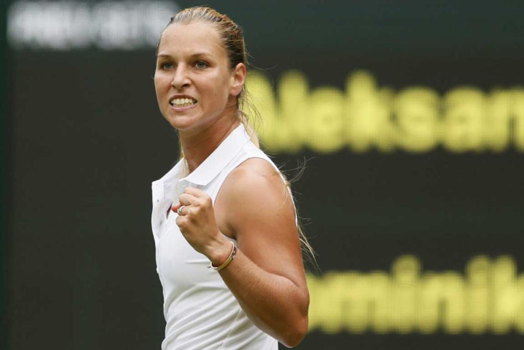 Dominika Cibulkova pumps her fist after overcoming Canada's Aleksandra Wozniak.