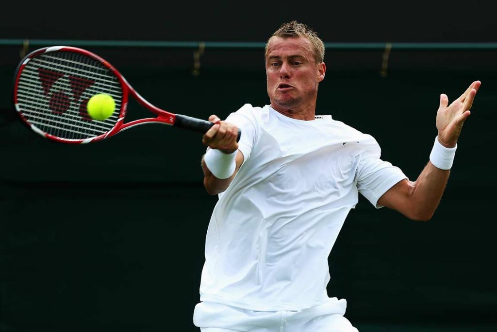 Lleyton Hewitt recovered from losing a long tiebreaker in the second set to see off Poland's Michal Przysiezny in four sets.