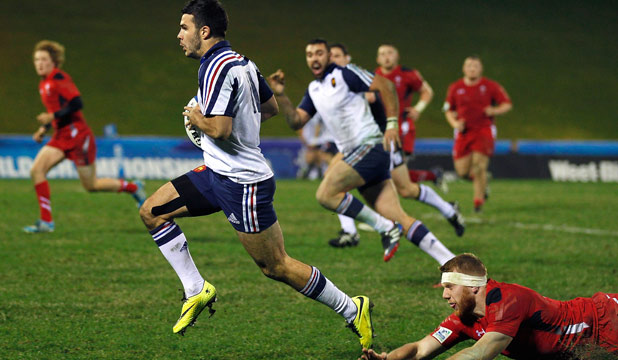 FULL FLIGHT: Arthur Bonneval of France beats the tackle of Jack Dixon of Wales during the 2014 Junior World Championship match at ECOLight Stadium, Pukekohe on June 15.