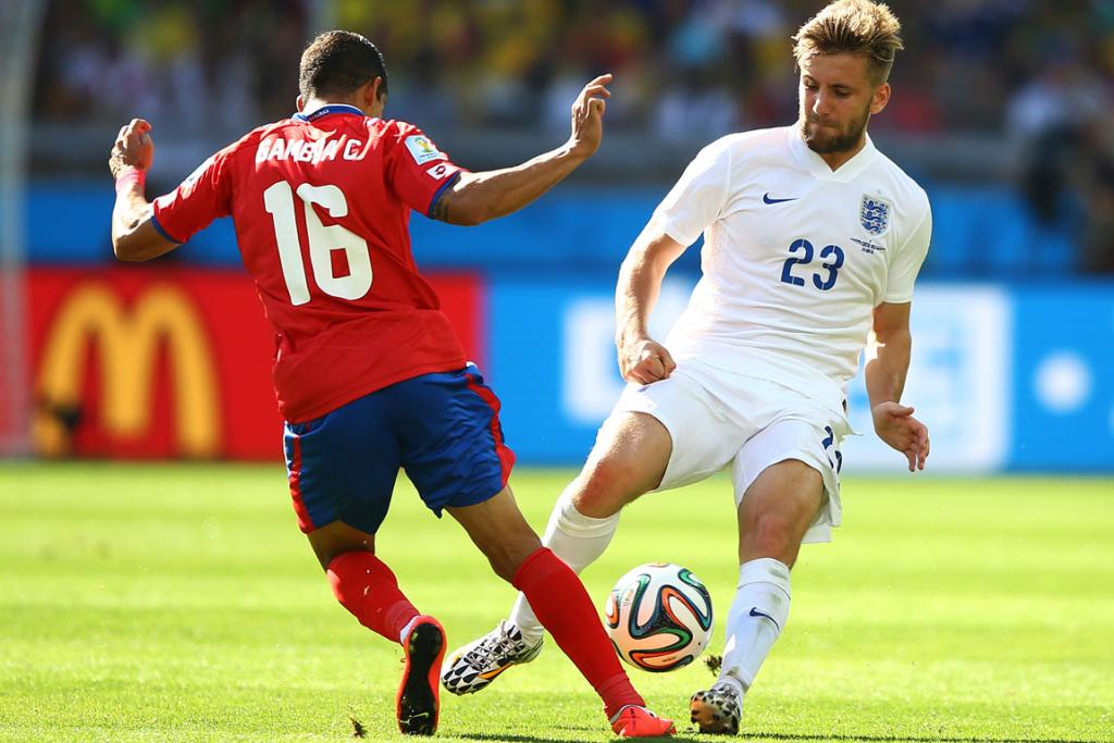 Cristian Gamboa of Costa Rica challenges Luke Shaw of England during their World Cup Group D match at Estadio Mineirao in Belo Horizonte, Brazil.