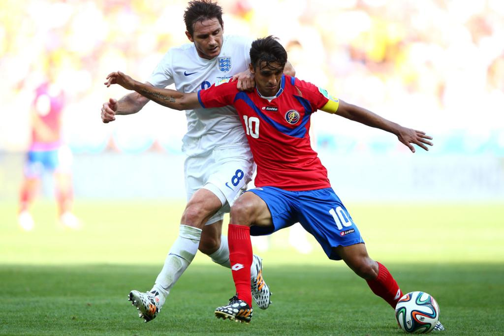 Bryan Ruiz of Costa Rica holds off a challenge by England's Frank Lampard during their Group D 0-0 draw in Belo Horizonte, Brazil.