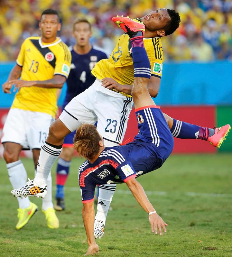 Japan's Yoshito Okubo tries to score past Colombia's Carlos Valdes.