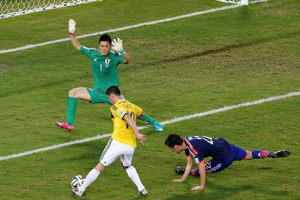 Colombia's James Rodriguez scores their fourth goal against Japan.