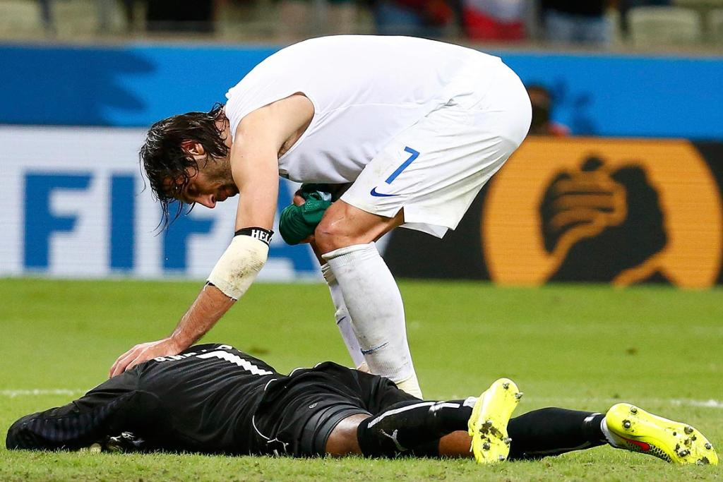 Greece's Giorgios Samaras consoles Ivory Coast's Boubacar Barry, after he scored a penalty past Barry.