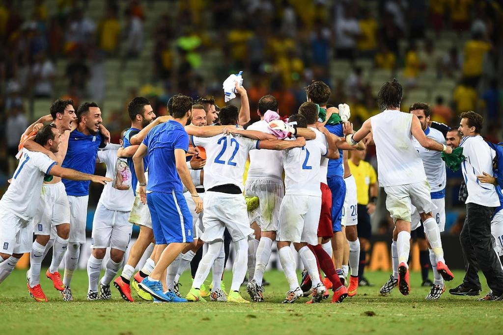 Greece celebrate after defeating the Ivory Coast 2-1.