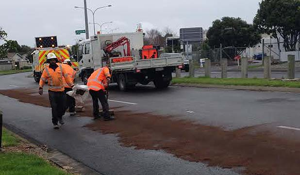 CLEAN UP: Work is being done to clear an oil spill in South Auckland.