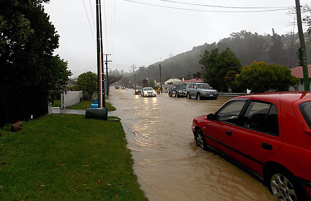 TAKE CARE: Cars carefully navigate floodwater on Kawai St South, between Boundary Rd and the hospital.