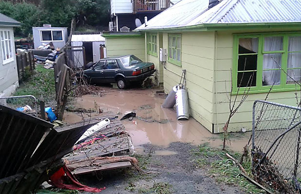 DESTRUCTION: Heavy rain flooded this Murphy St driveway, and appears to have brought down a surrounding fence.