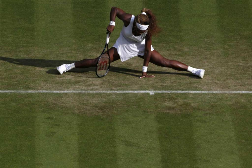 Serena Williams stretches into the splits after she plays a shot during her win over Anna Tatishvili of the US.