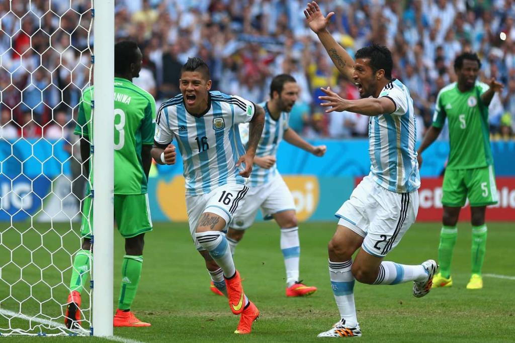Marcos Rojo celebrates his match-winning goal, scored off his knee, in Argentina's 3-2 victory over Nigeria.