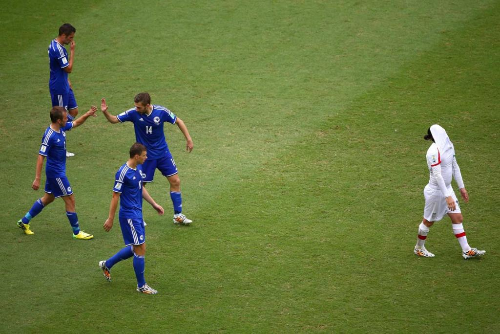 Bosnia-Herzegovina players celebrate after their second goal in a 3-1 victory over Iran.