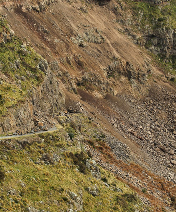 ROCKY ROAD: Christchurch City Council workers blast hazardous rocks from above Summit Rd.