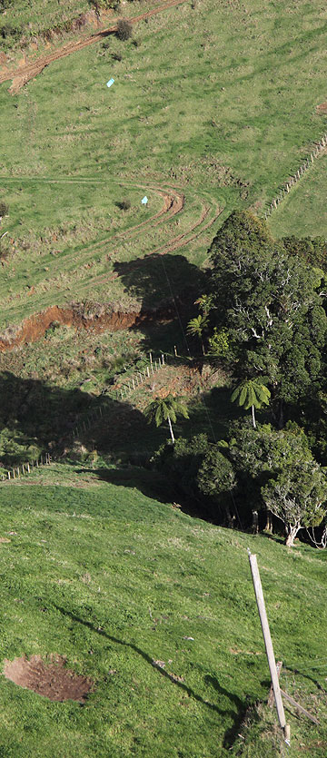 Even though the wire across this gully on an eastern Taranaki farm is flagged, it is difficult to see.