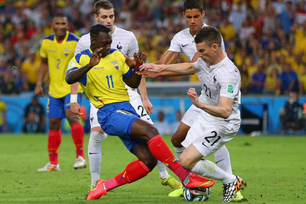 Felipe Caicedo of Ecuador challenges Laurent Koscielny of France during their World Cup Group E match at the Maracana Stadium in Rio de Janeiro, Brazil.