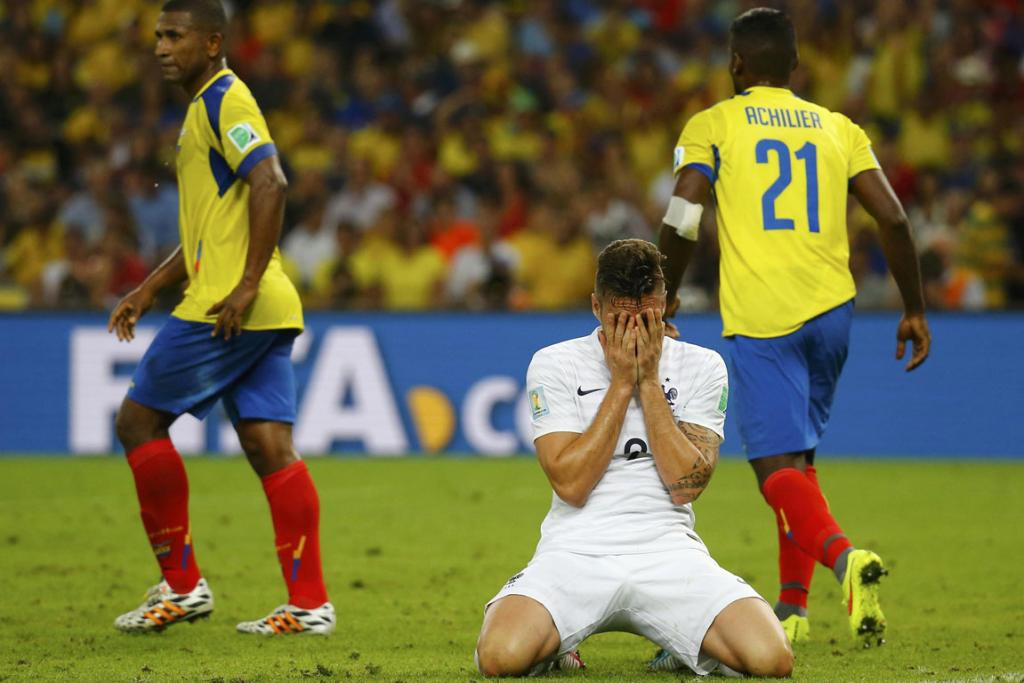 France's Olivier Giroud (second right) reacts after missing a chance to score against Ecuador at the Maracana Stadium in Rio de Janeiro.