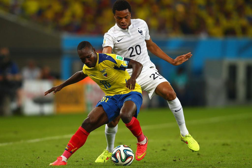 Oscar Bagui of Ecuador controls the ball against Loic Remy of France during their Group E World Cup match.