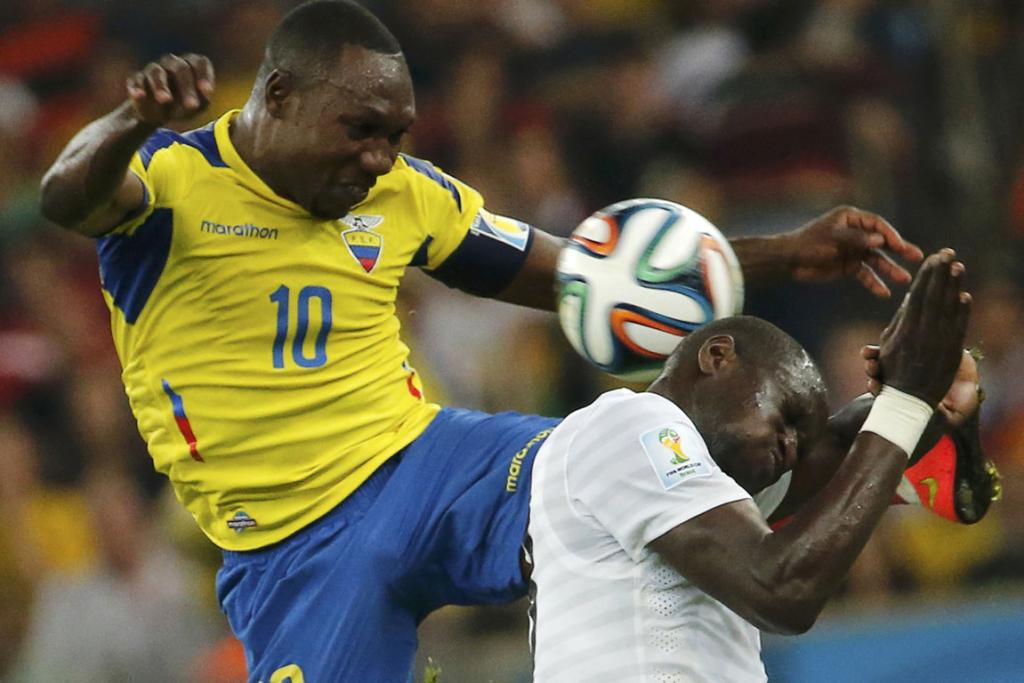 Ecuador's Walter Ayovi fights for the ball with France's Moussa Sissoko (right) during their Group E match at the Maracana Stadium in Rio de Janeiro.