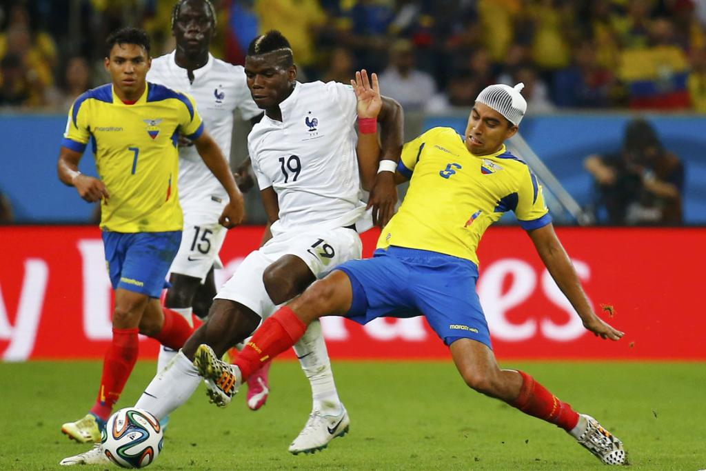 France's Paul Pogba (centre) fights for the ball with Ecuador's Cristian Noboa (right) during their 0-0 draw in Rio de Janeiro.