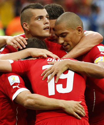 EASY WIN: Swiss players celebrate their comfortable 3-0 win over Honduras in Manaus.