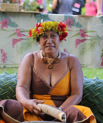 Women from the village of Omoa, Fatu Hiva create umuhei, a parcel of scented flowers, worn in their hair or around their neck as an aphrodisiac.