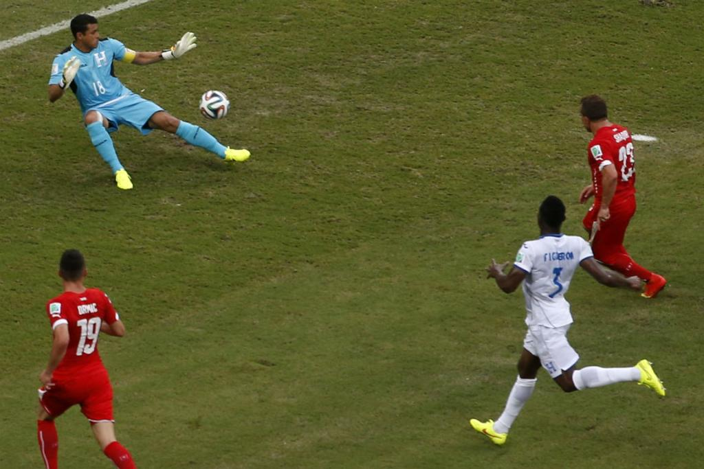 Switzerland's Xherdan Shaqiri fires his second goal past Honduran goalkeeper Noel Valladares.