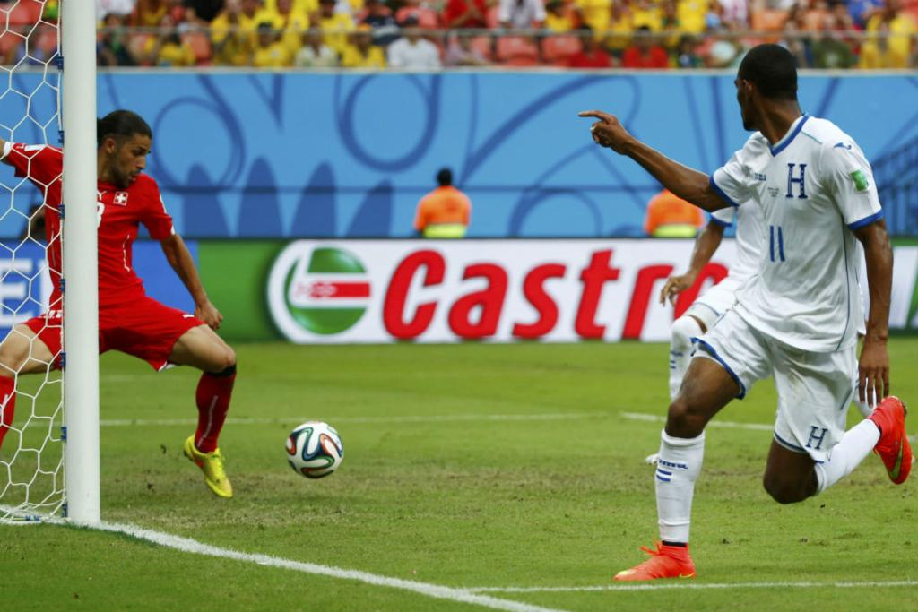 Jerry Bengtson of Honduras (right) watches as his shot is cleared off the line by Switzerland's Ricardo Rodriguez.