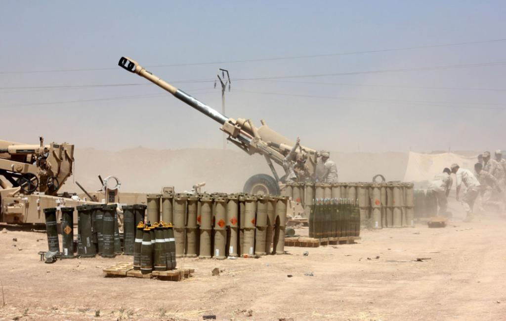 Iraqi security forces fire artillery during clashes with ISIL on the outskirts of the town of Udaim.