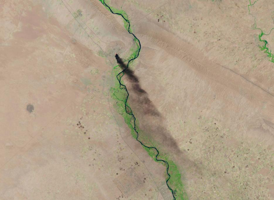 A U.S. Geological Survey satellite image shows smoke rising from the Baiji refinery near Tikrit, Iraq.