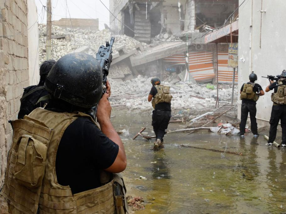 Members of the Iraqi Special Operations Forces patrol Ramadi looking for ISIL militants.